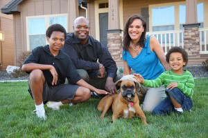 Family and Dog on grass of house.