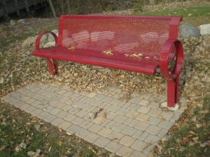 Park benches with brick pavers.