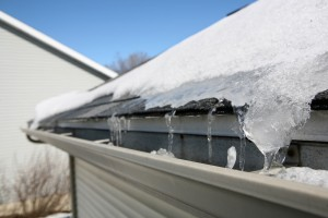 bigstock-Ice-on-roof-and-gutters-52324966
