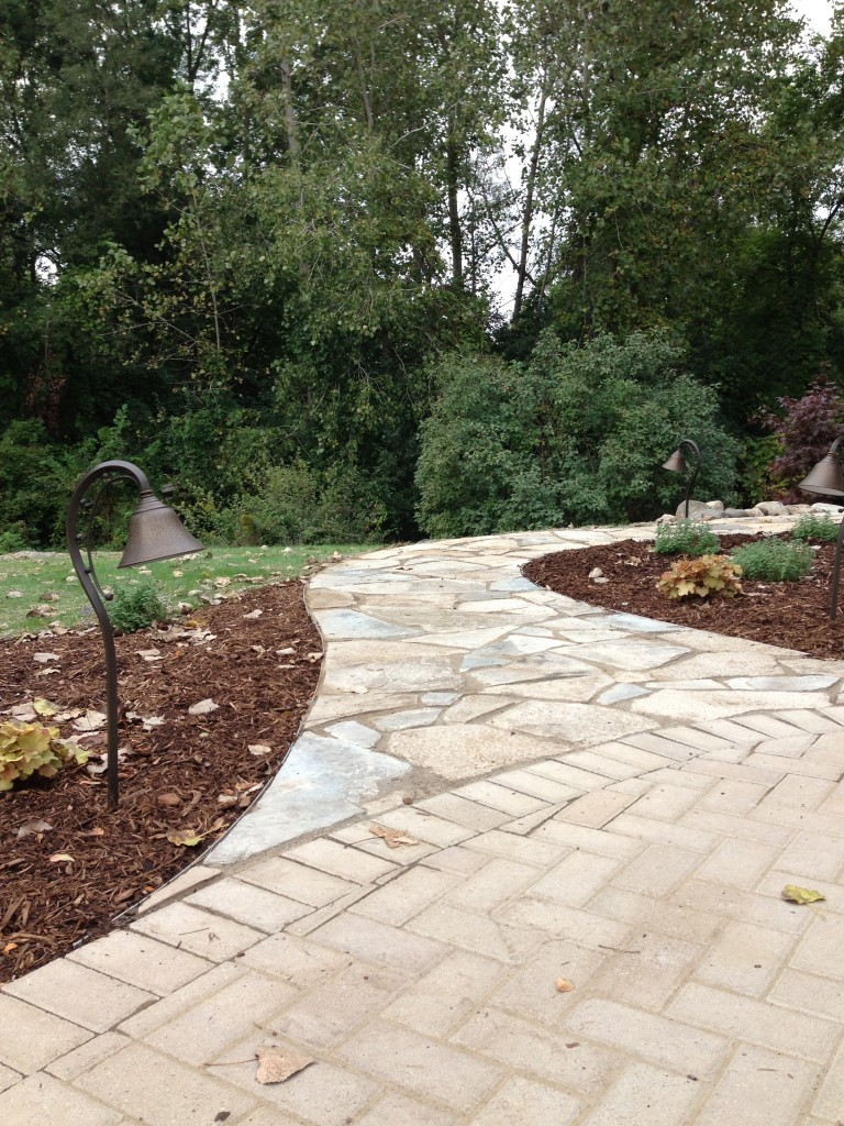 Curved pathway off paver driveway