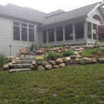 Boulder retaining wall on slope