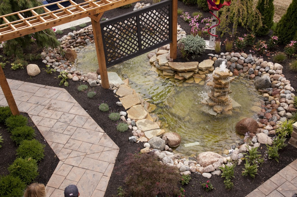 Landscaped Backyard With Fountian