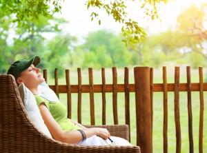 Cute girl resting on veranda, young traveler woman sleeping on b