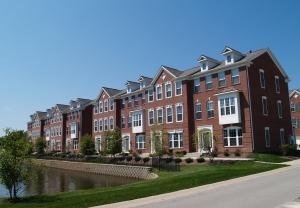 Row of Brick Condos With Bay Windows