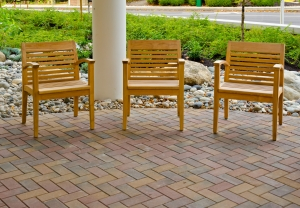 Three chairs next to the entrance to building