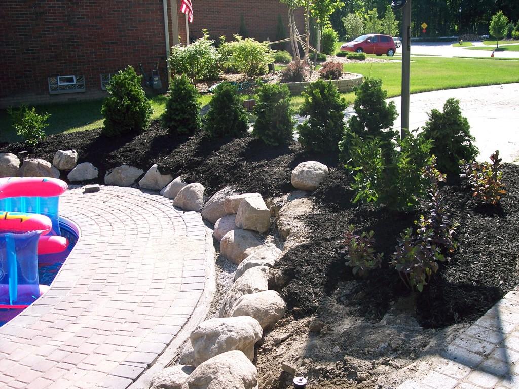Install Boulders & Plants