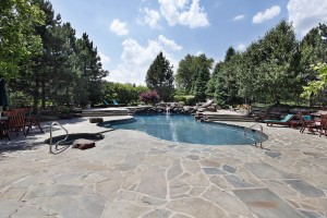 Swimming Pool With Large Stone Patio