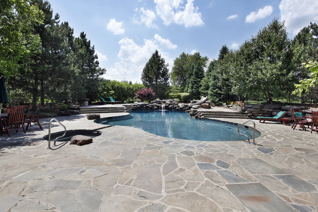 Swimming Pool With Large Stone Patio Hardscaping ...