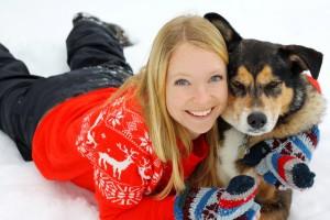 Woman Hugging German Shepherd Dog In Snow