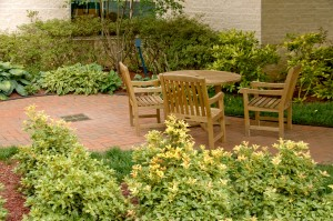 Outdoor patio with wooded furniture and plants