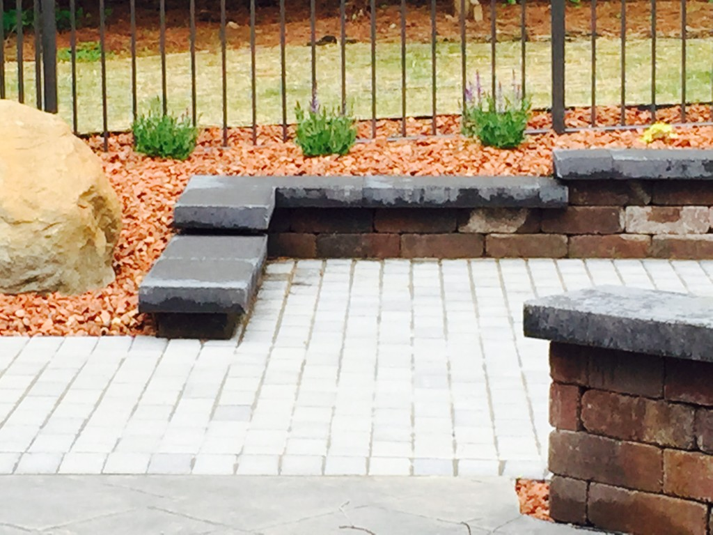 Stone Toped Wall With Patio