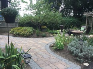 Landscaped yard with brick pavers