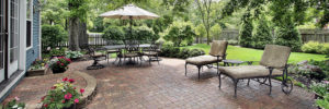 Outdoor Living Space with beautiful paver patio and professional landscape.