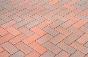Close up of a professionally laid brick paver walkway.