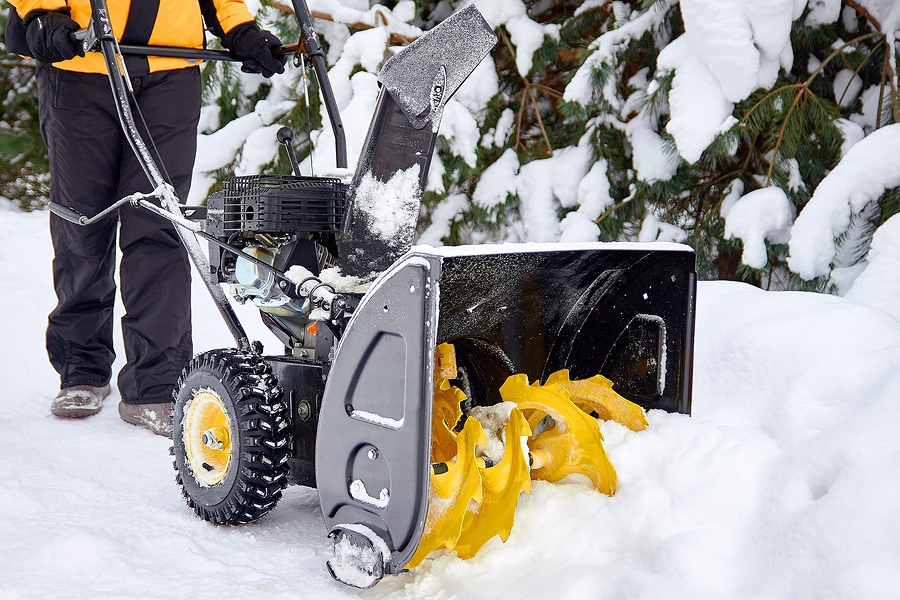 Commercial Landscape Management company clearing snow after a snow storm.