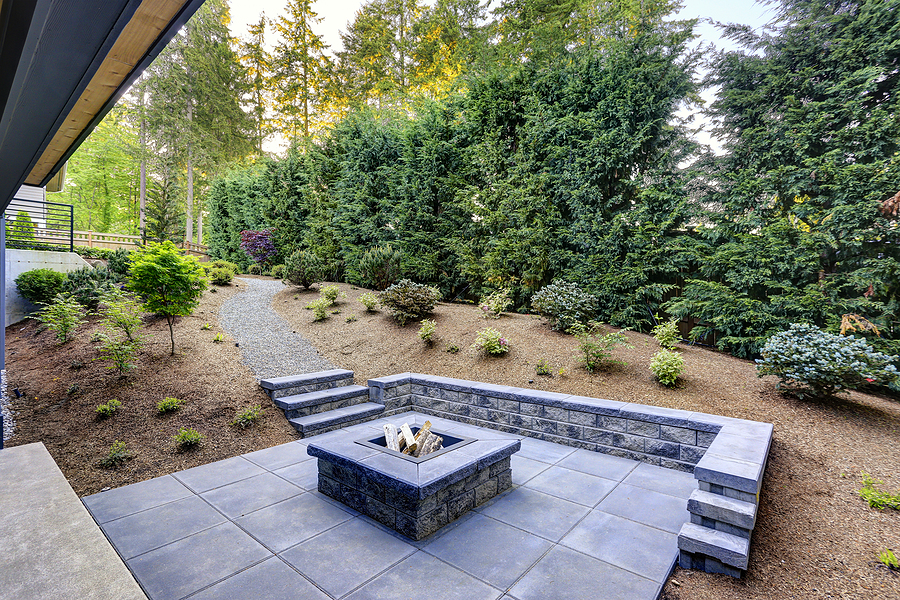 Nice modern fire pit with landscape paver surround.