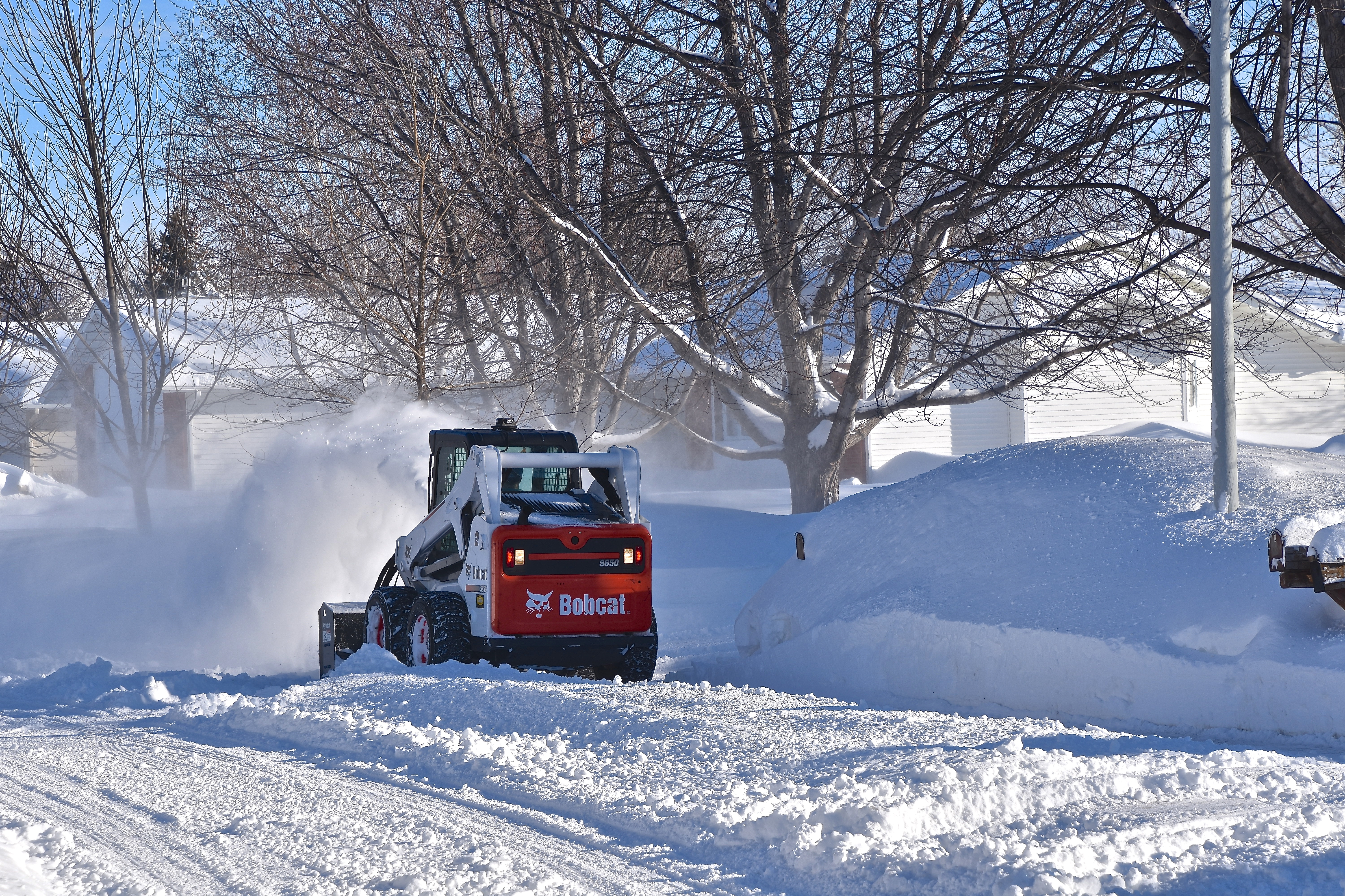 Snow removal after a winter storm in an HOA neighborhood.
