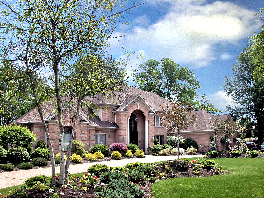 Beautiful luxury home with well maintained landscaping.