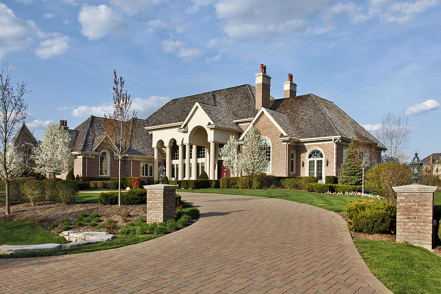 Luxury home with beautiful patio paver driveway.