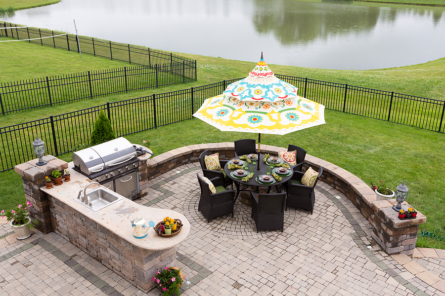 Beautiful outdoor living space with outdoor kitchen and dining areas.