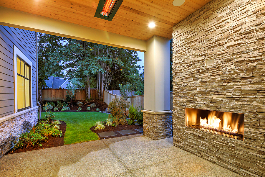 Nice new landscape design with a patio and outdoor fireplace.