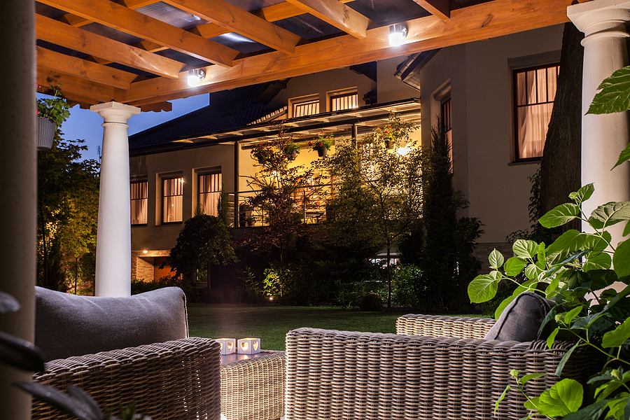 Picture of beautiful residence with garden at night.