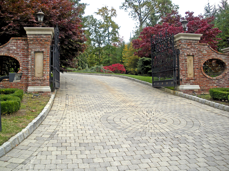 Grand entrance with custom designed driveway made out of high quality pavers.